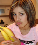 Teen Teasing While Eating Big Banana - Picture 1